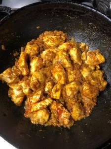 adding spices to chicken mixture